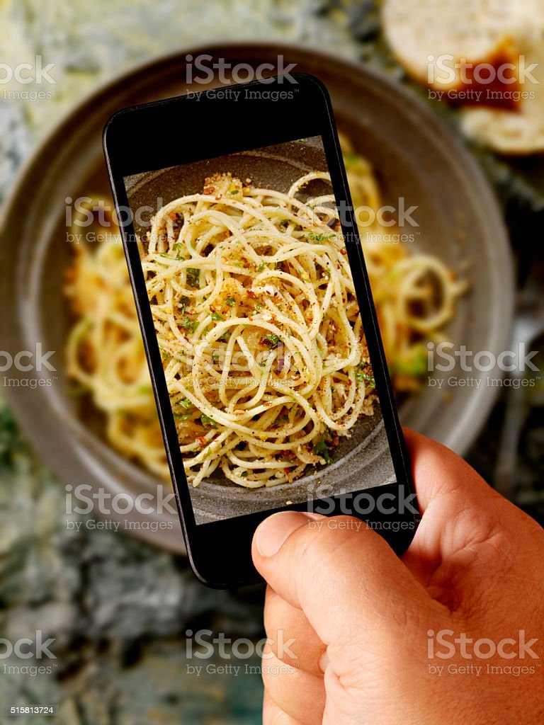 mobile photography of Spaghetti Toasted in Olive Oil stock photo