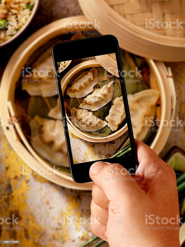 Mobile Photography of Steamed Dumplings stock photo