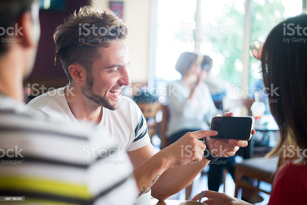 Mobile presentation in coffee shop stock photo