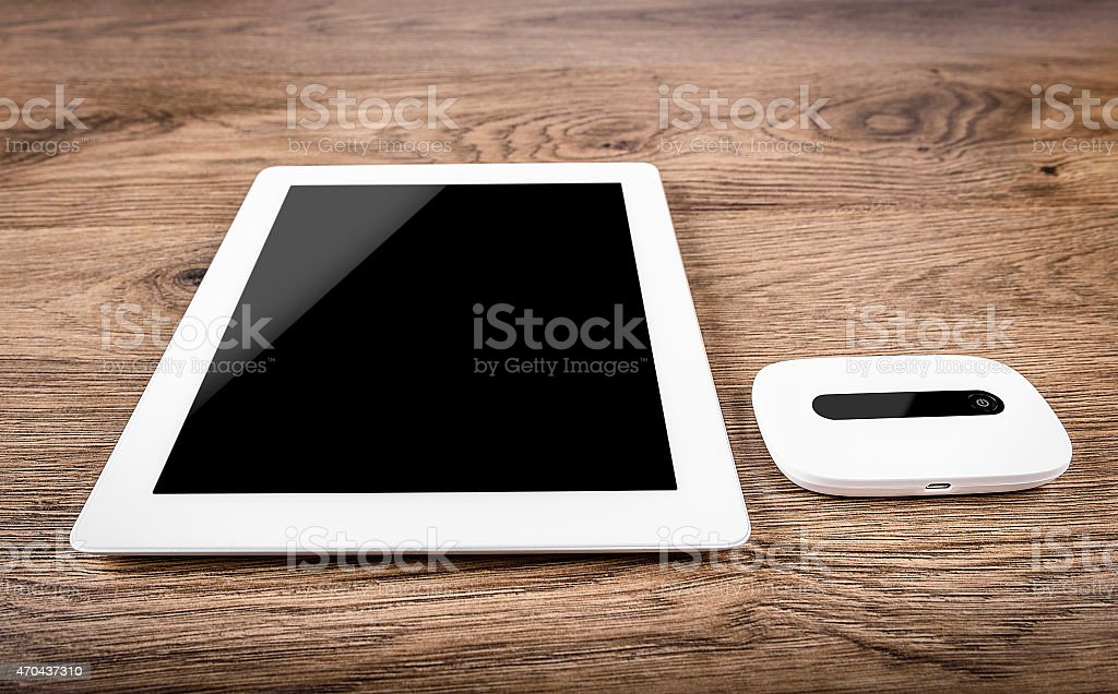 Mobile router with tablet pc. 3G or LTE network concept stock photo