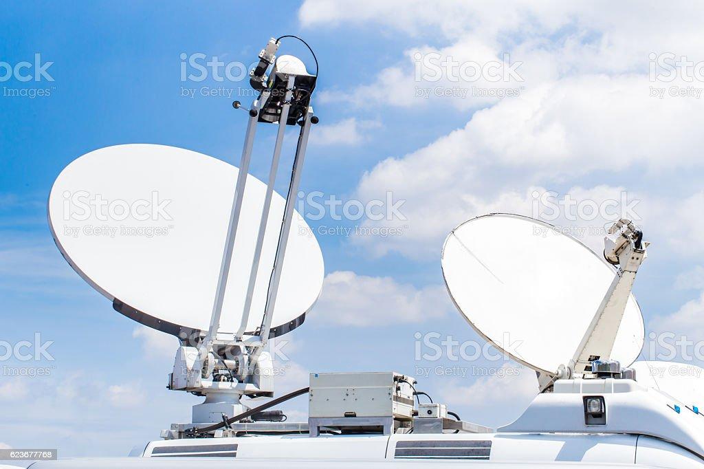 mobile satellite dish, digital media broadcast and data communication concept. stock photo