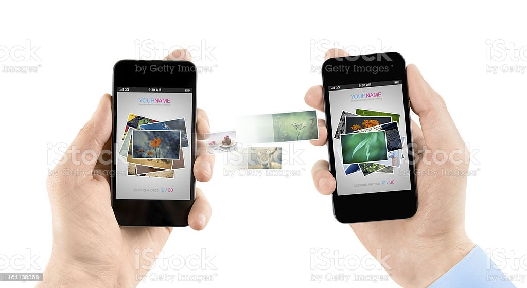 Mobile smart phones while transferring pictures stock photo
