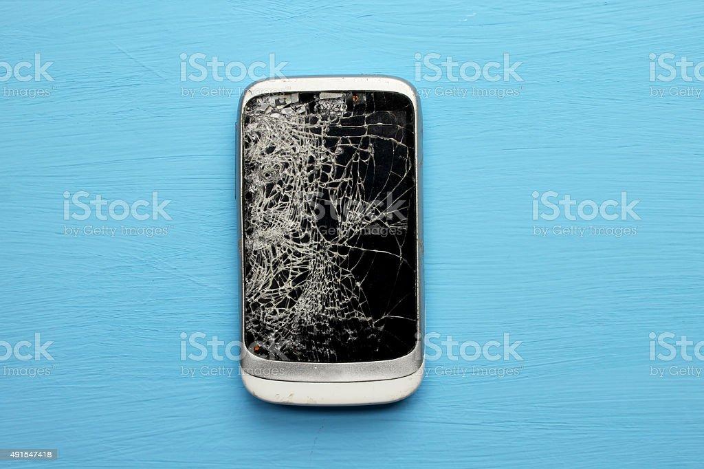 Mobile smartphone with broken screen stock photo