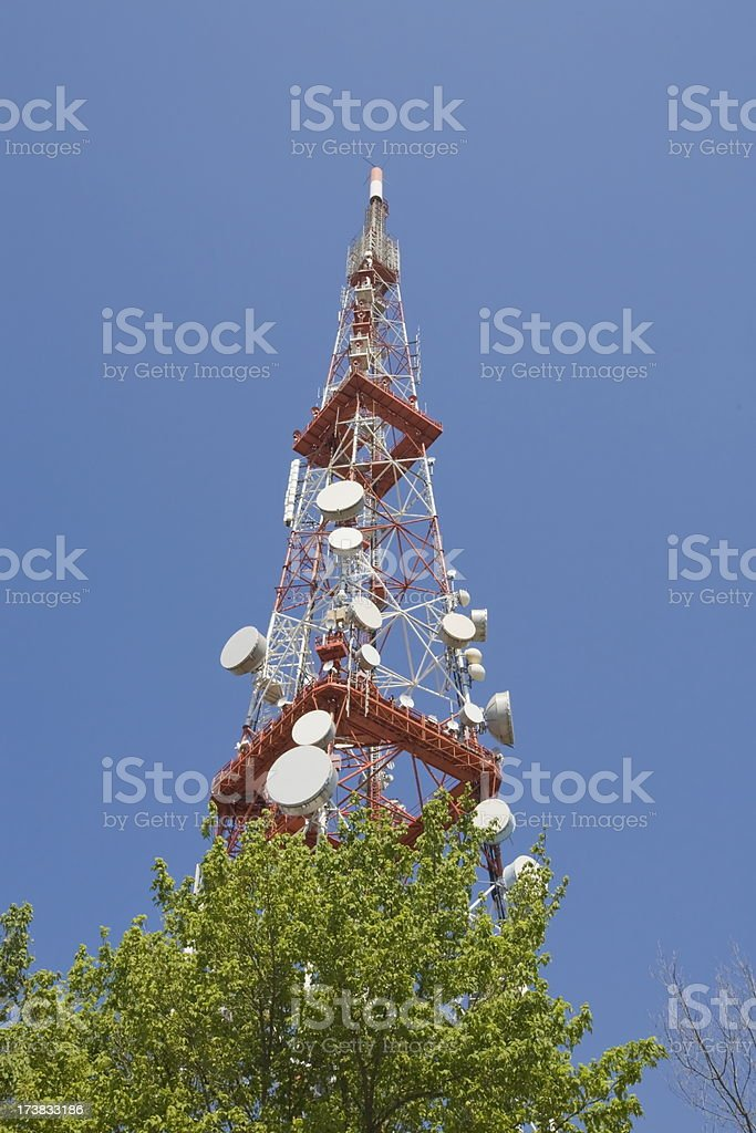 Mobile telephones and television tower stock photo