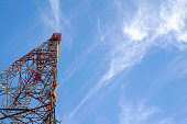 Mobile tower communication antennas with blue sky