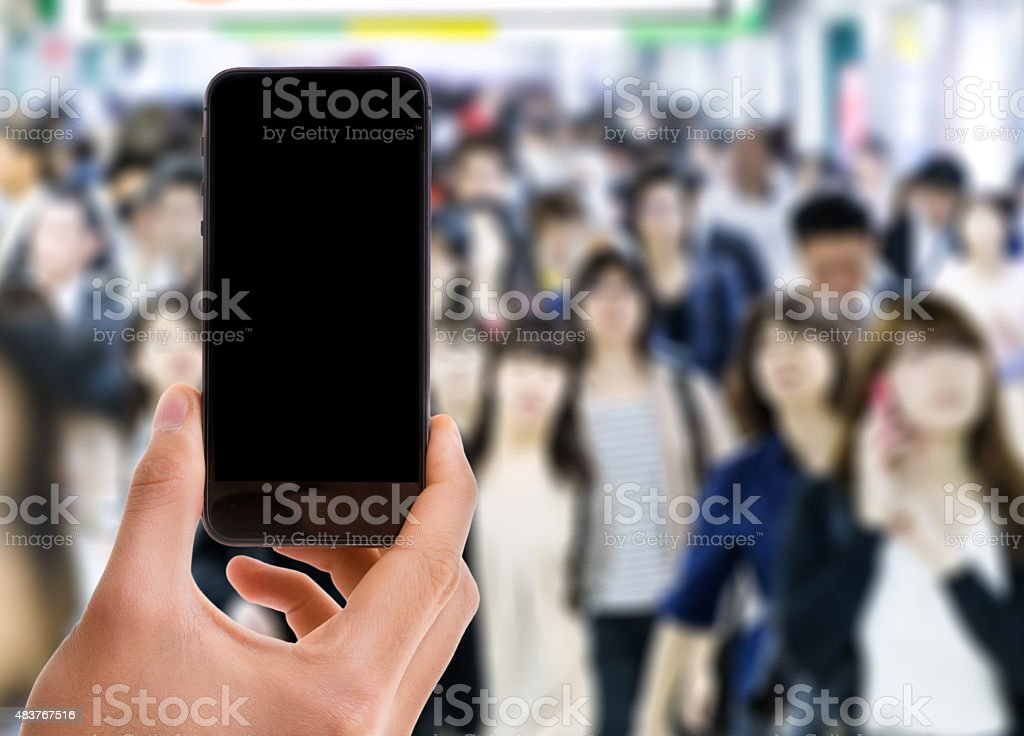 Mobile with black screen with a crowd of people stock photo