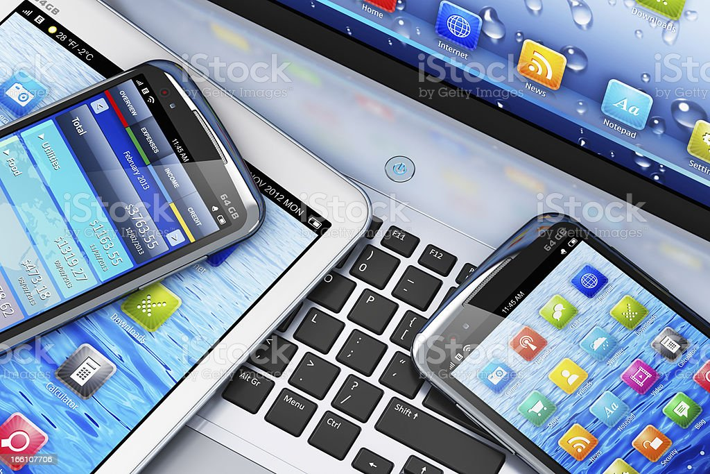 Mobility concept with digital devices on laptop stock photo