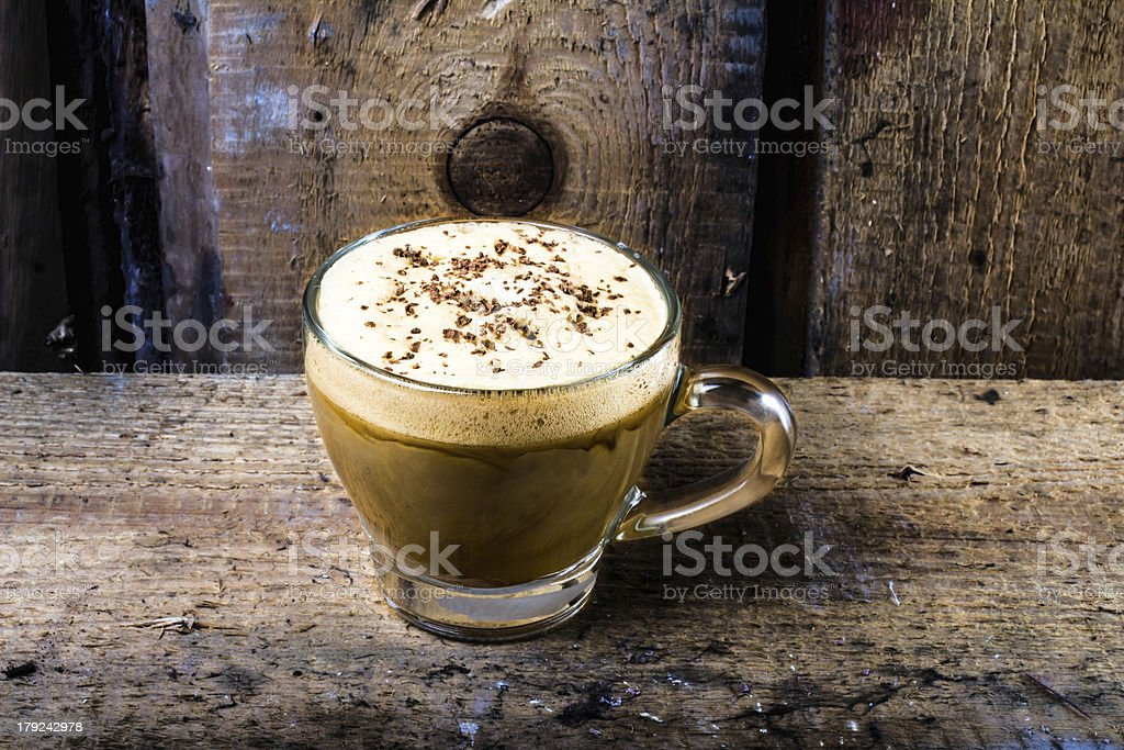 Mocha coffee in  Glass cup with foam cream topped royalty-free stock photo