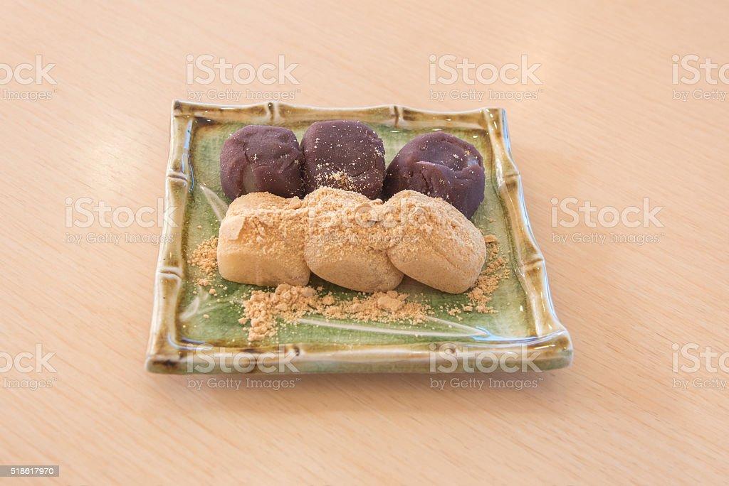 mochi japan rice cake with soybean flour stock photo
