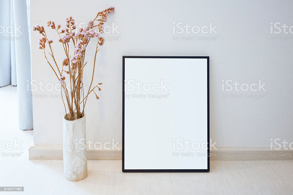 Mock up Blank photo frame on floor Home interior decoration stock photo