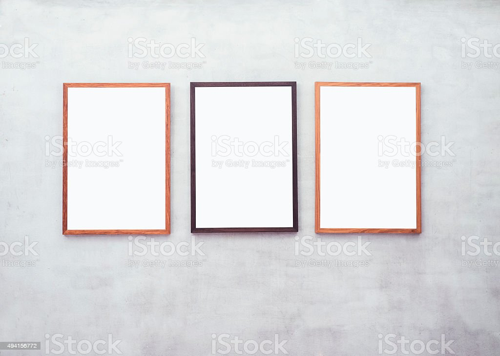 Mock up Blank Posters with Wooden frame on Cement wall stock photo