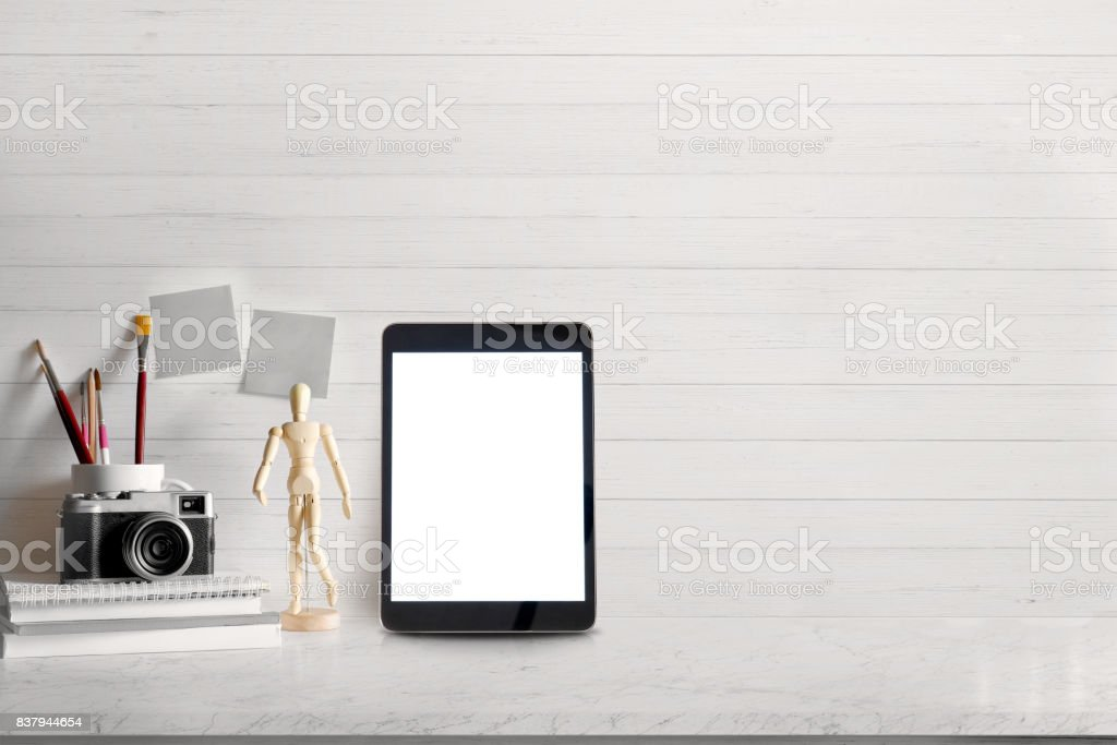 Mock up Blank screen tablet and modern home decor with camera, dummy. Artist workspace stock photo