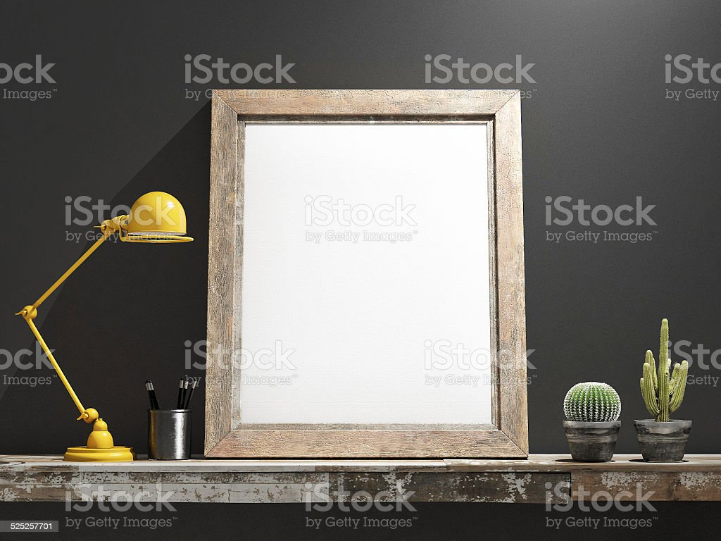 Mock up Frame on Wooden table, grey wall stock photo
