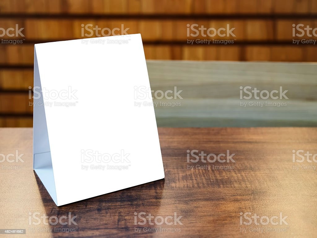 Mock up Menu Frame template on table in Restaurant cafe stock photo