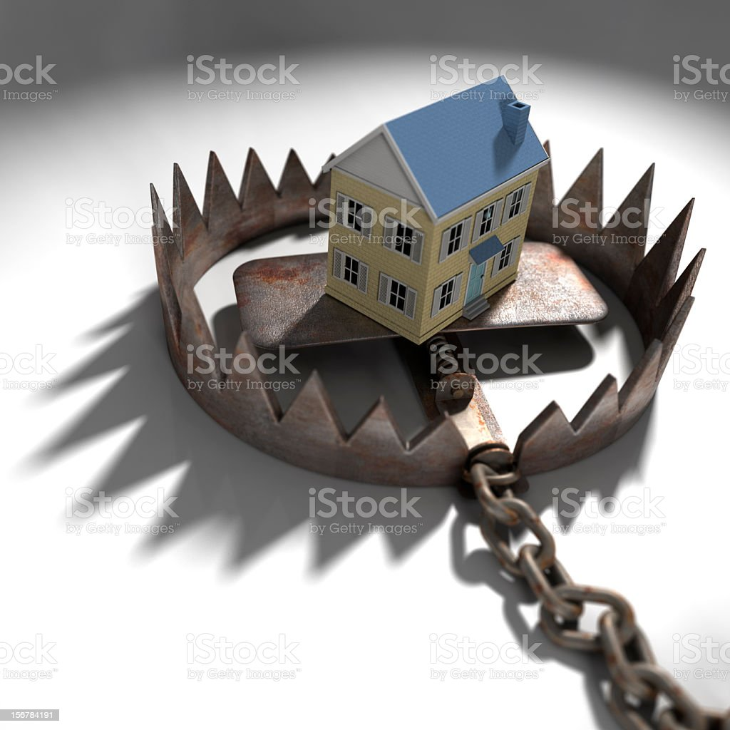 Mock up of a house in a trap, symbolizing mortgage pressure stock photo