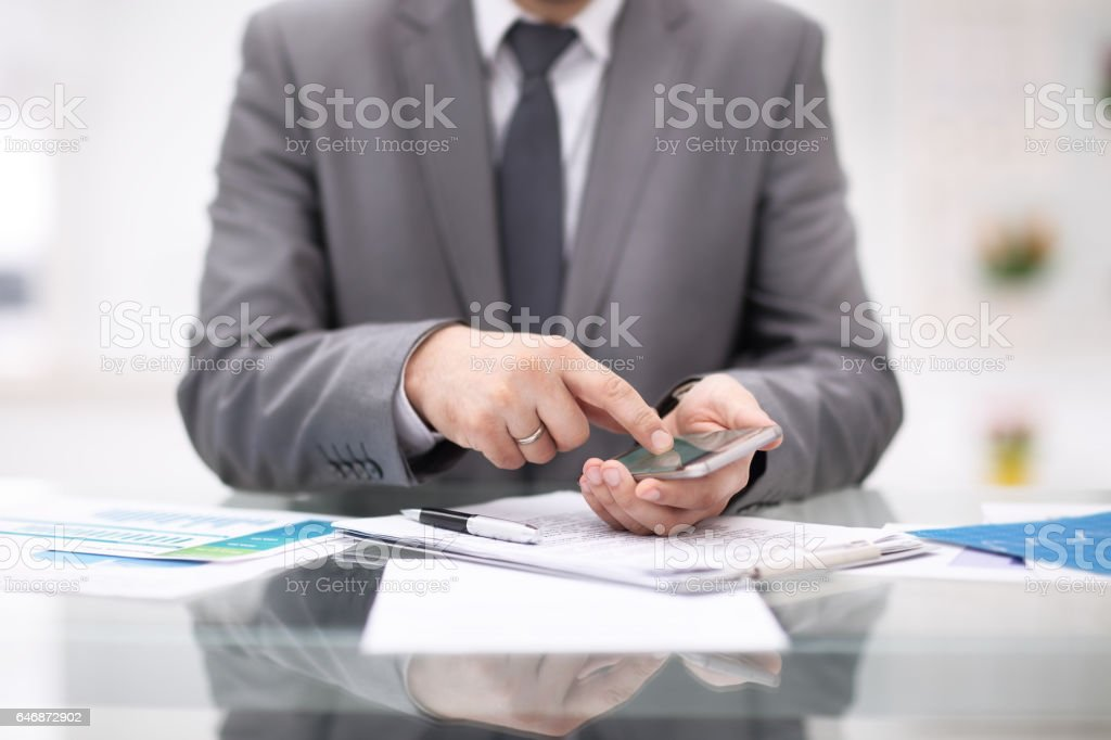 Mock up of a man holding device and touching screen stock photo