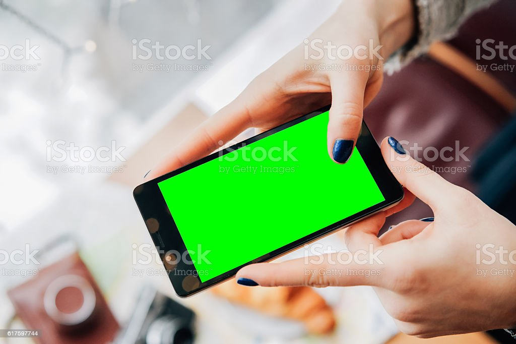 Mock up of phone's screen held by woman's hands stock photo