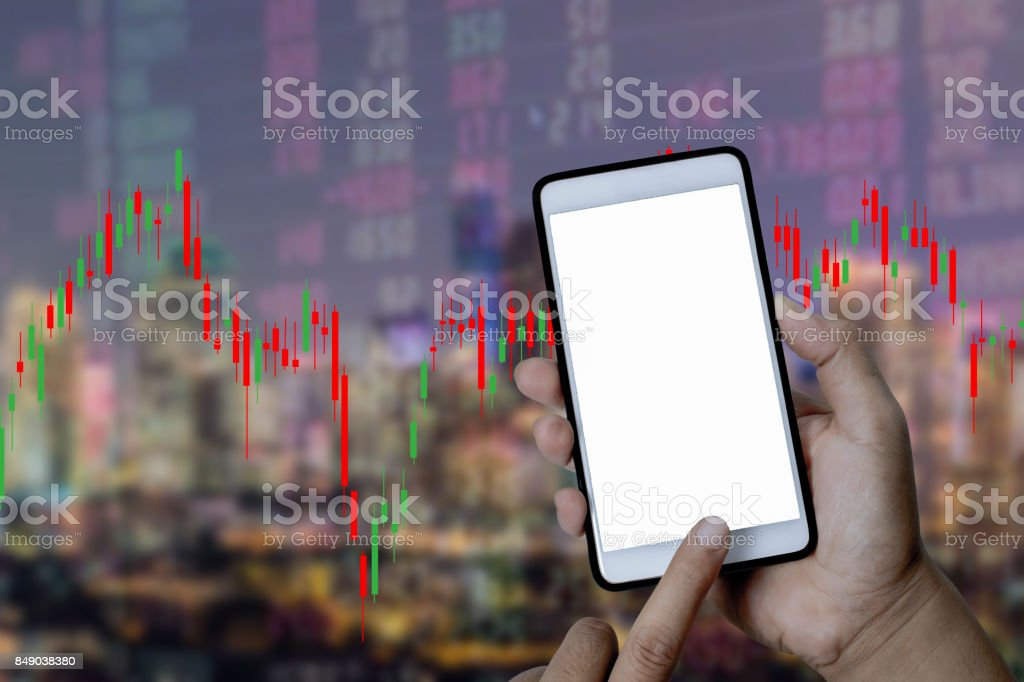 mock up of smart phone on hand for purchase stock market exchang business technology element concept. stock photo