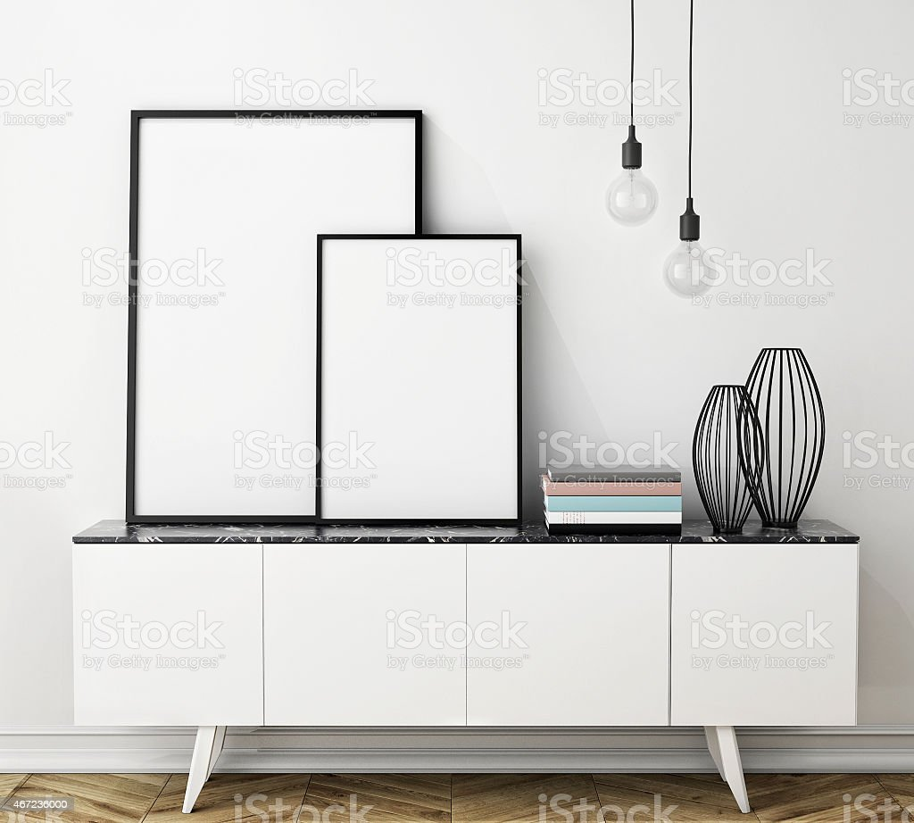 mock up poster frame on chest of drawers, interior stock photo