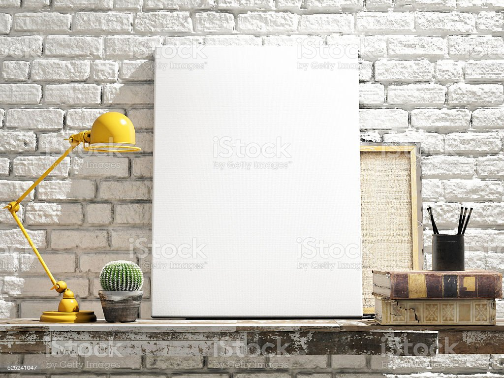 Mock Up Poster on table. White Brick Background stock photo