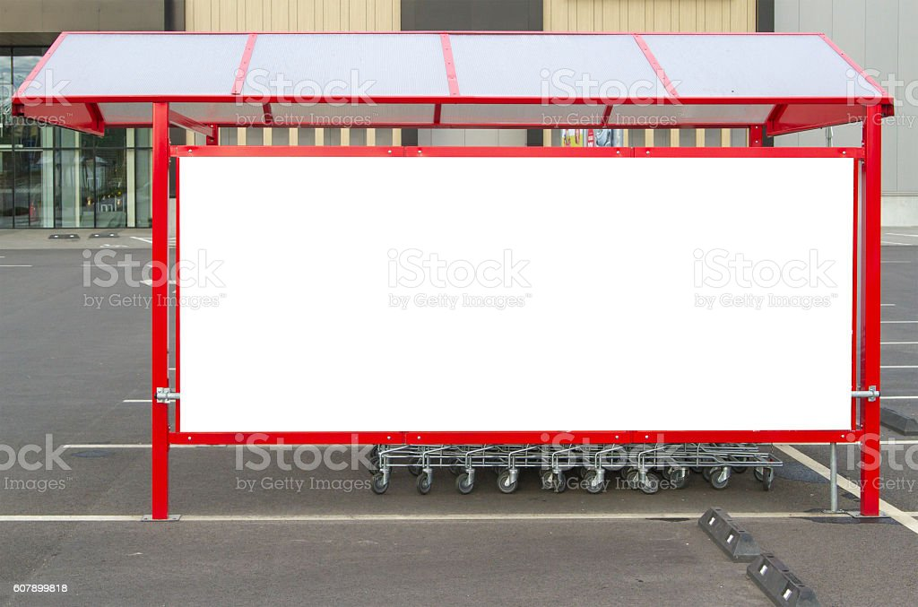 Mock up. Shopping carts return point on a parking lot stock photo