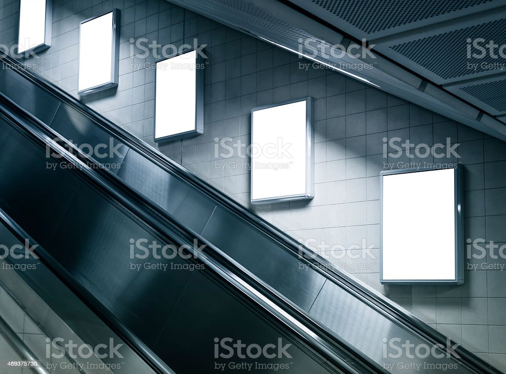 Mock up Vertical Poster in Subway station with escalator stock photo