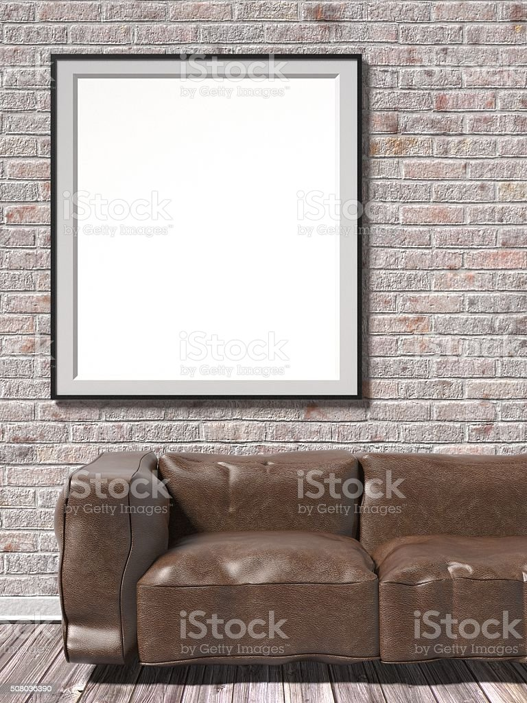 Mock up white empty picture frame with brown leather sofa stock photo