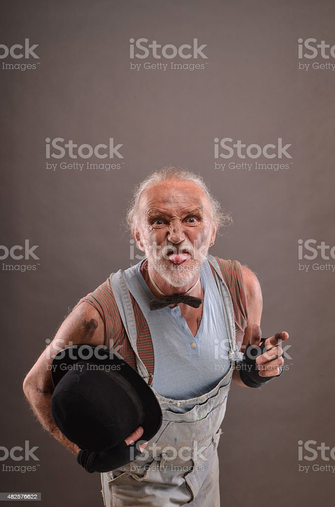 Mocking old beggar stock photo