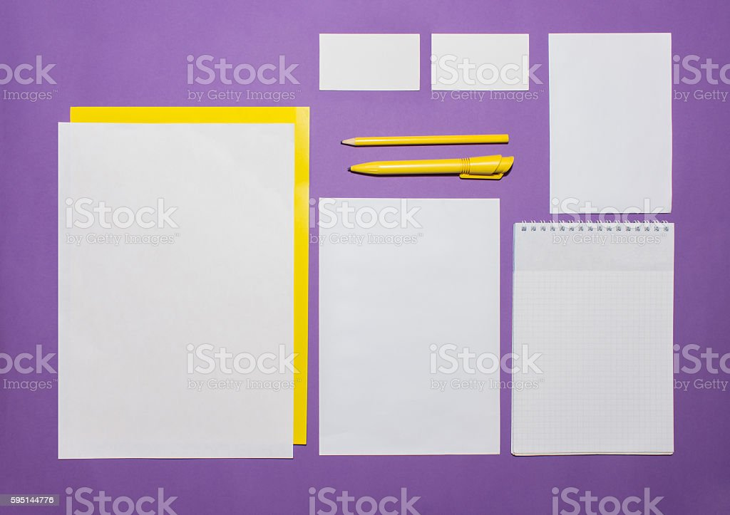 Mock-up business template with cards, papers, pen. Lilac background. stock photo