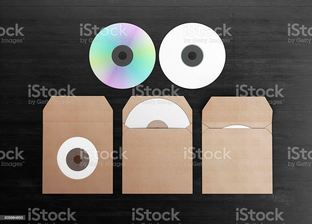 Mock-up for branding identity. Blank dvd in cardboard packaging. stock photo