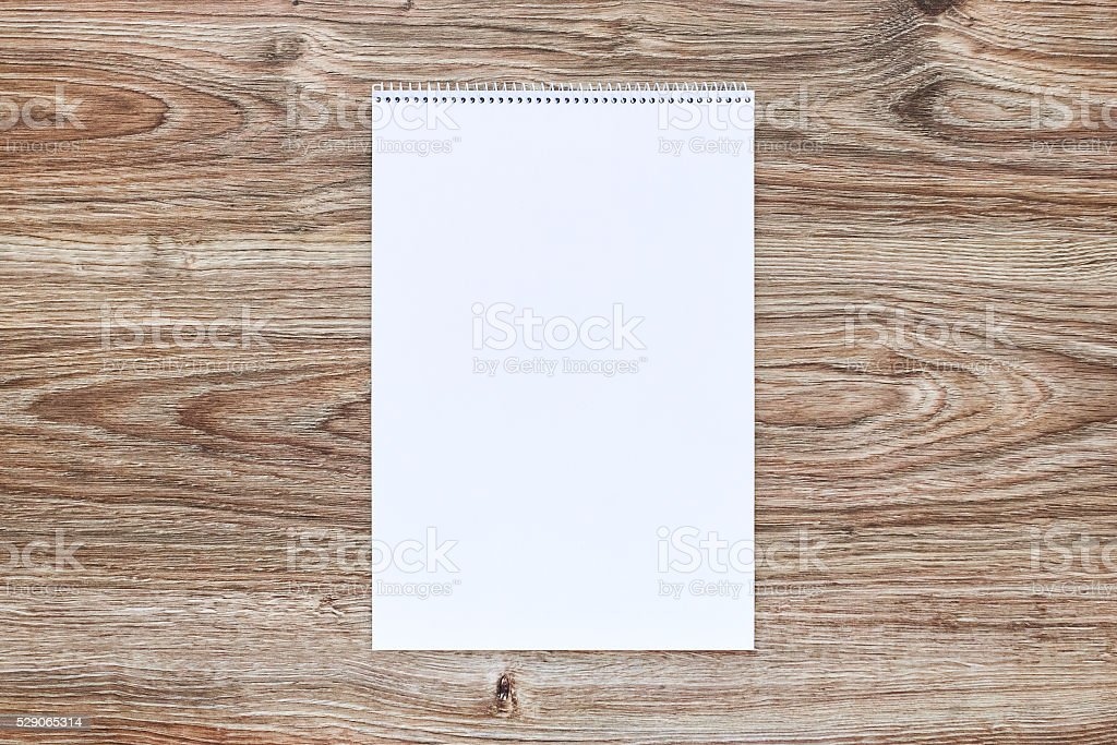 mockup of open album with blank white page. Vertical orientation stock photo