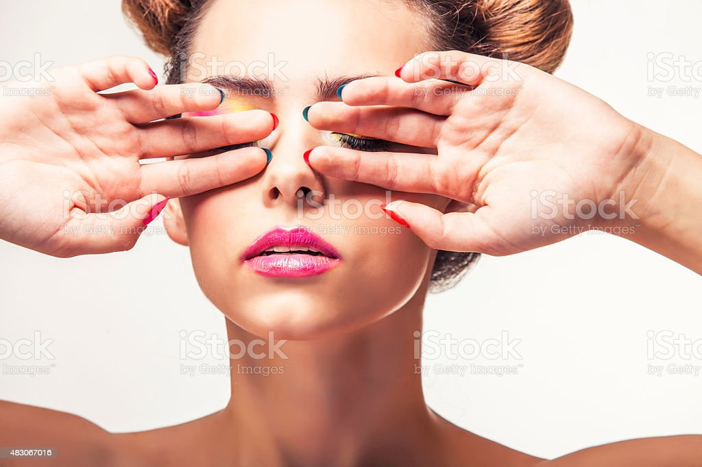 Model, a woman with bright makeup and bright nail Polish stock photo