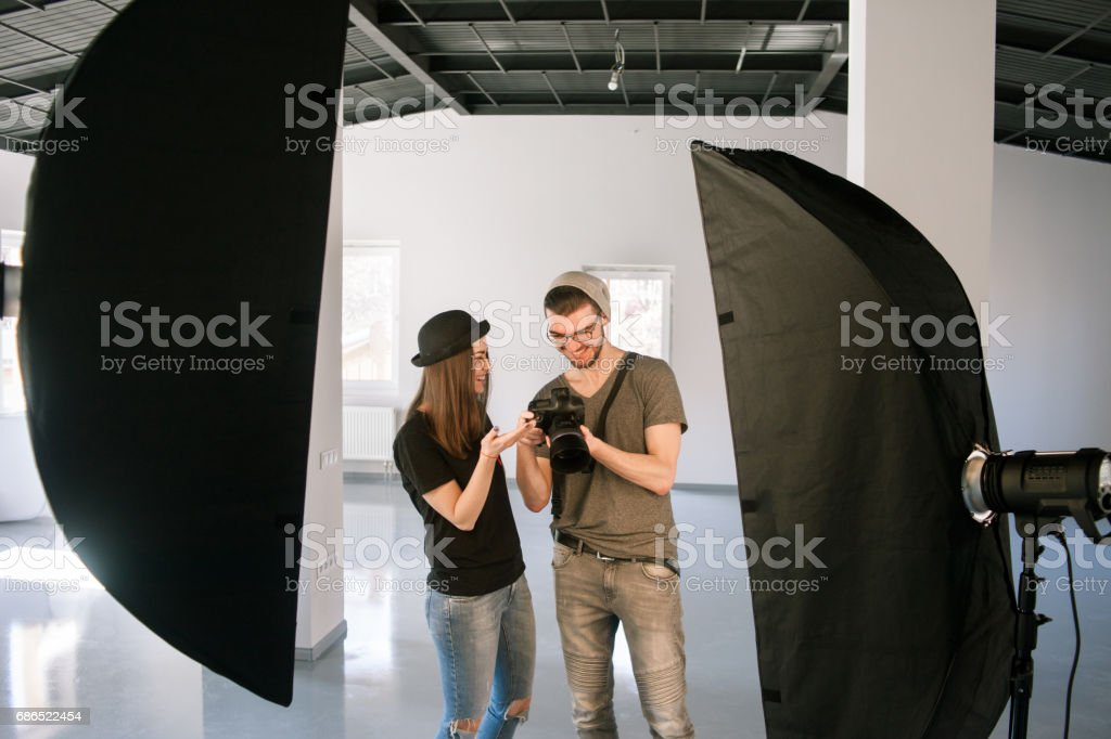 Model and photographer enjoy photos on camera stock photo