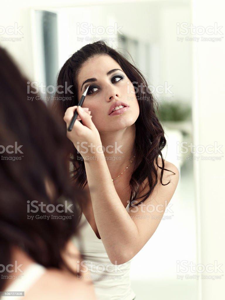 Model applying eye shadow royalty-free stock photo