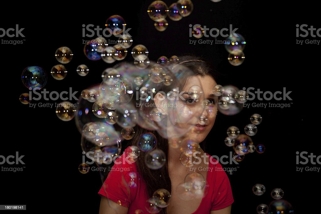 Model Behind A Wall Of Bubbles royalty-free stock photo