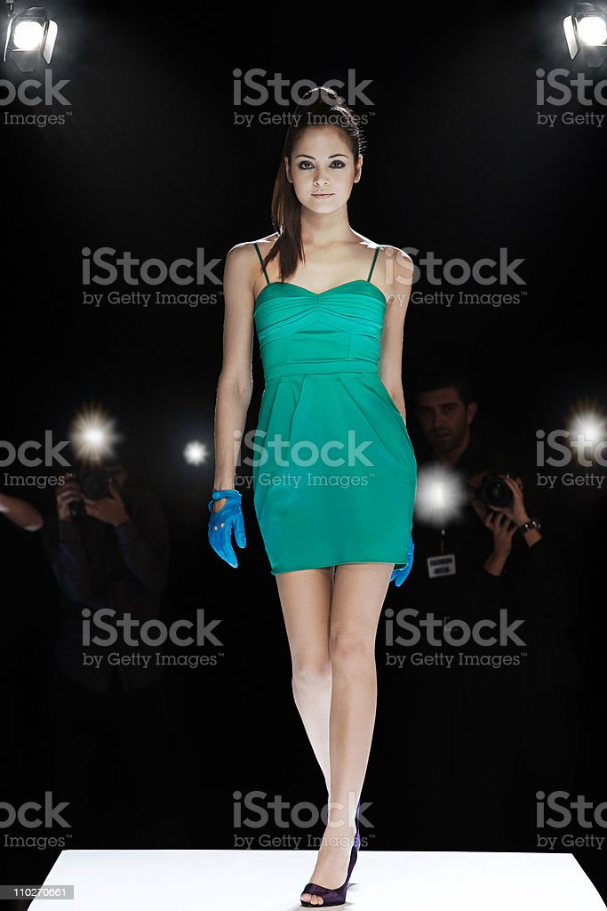 Model being photographed on catwalk at fashion show stock photo