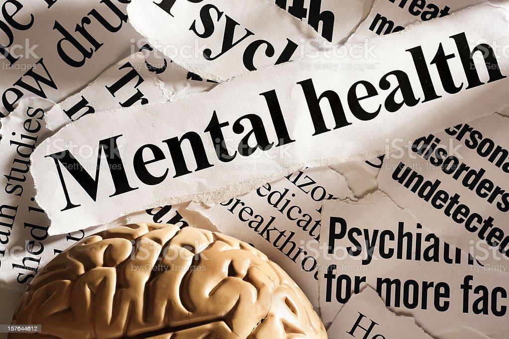 Model brain with headlines on mental health stock photo