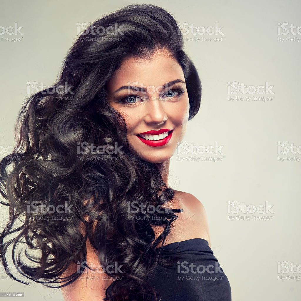 Model brunette with long curly hair stock photo