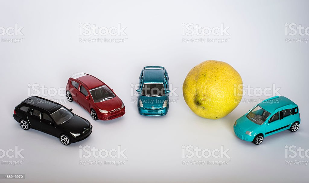 Model cars and a lemon in circle stock photo