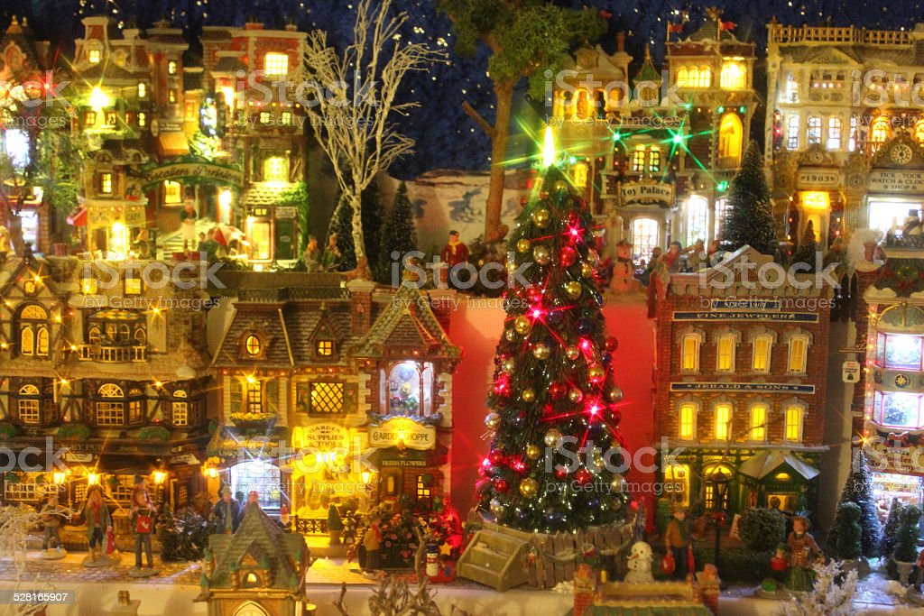 Model Christmas village with miniature houses, people, winter-scene, night-time lights stock photo