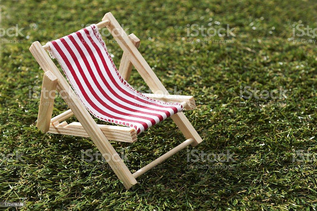 Model Deckchair On Grass royalty-free stock photo