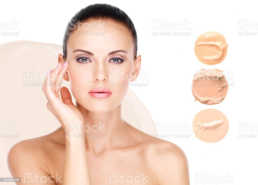 Model face of beautiful woman with foundation on skin stock photo