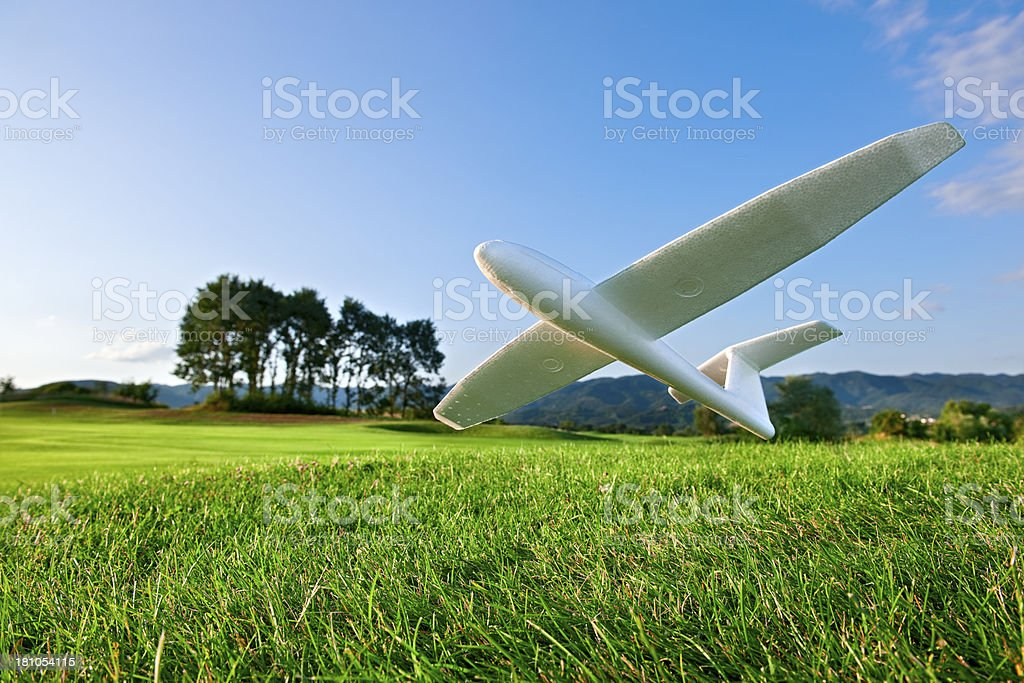 Model Glider Landing On A lawn.Color Image royalty-free stock photo