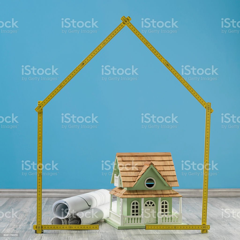 Model House And Blue Prints In On The Floor stock photo