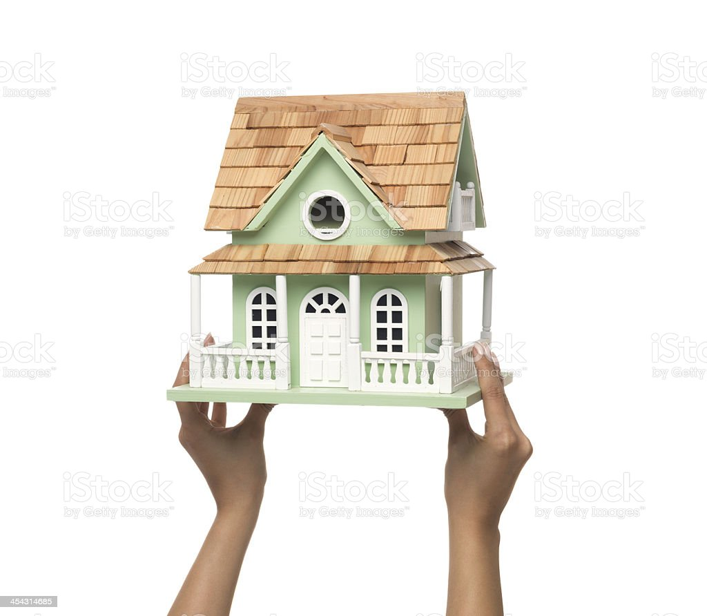 Model house in woman hand on white background royalty-free stock photo