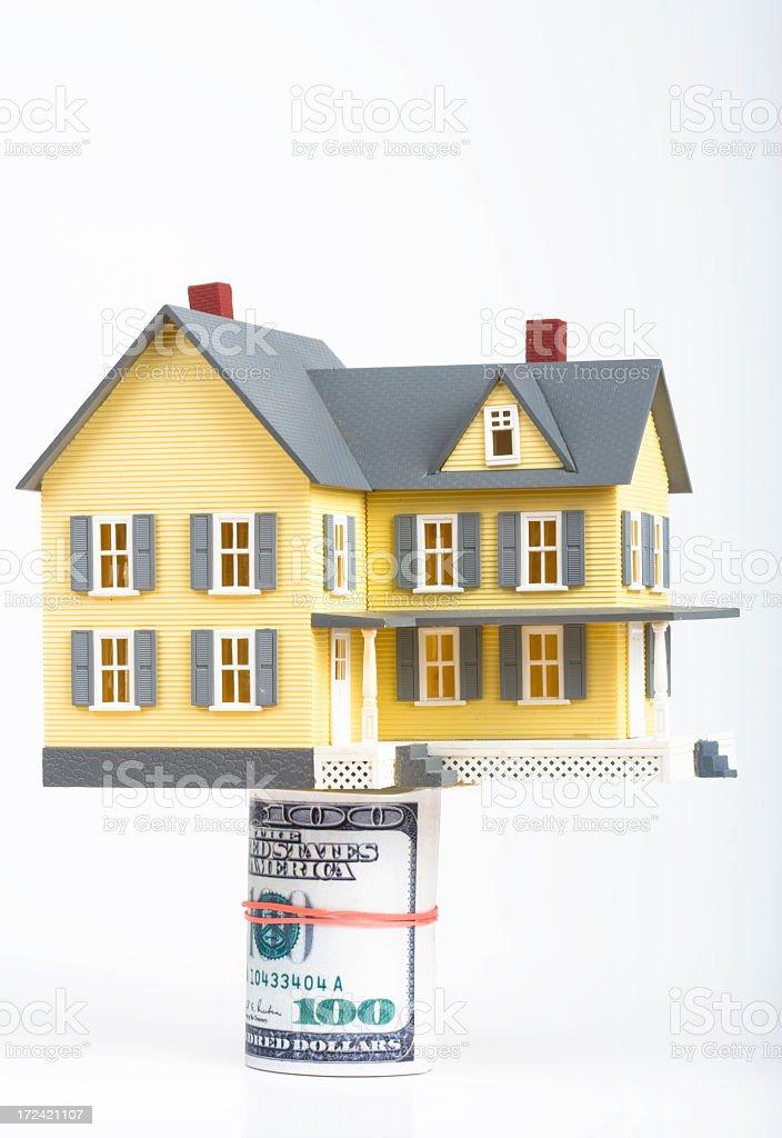 Model house on 100 dollar bills royalty-free stock photo