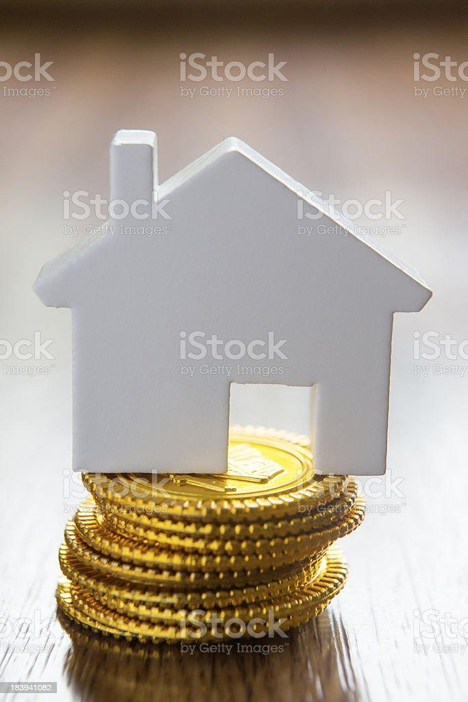 Model House On Stack Of Gold Coins royalty-free stock photo