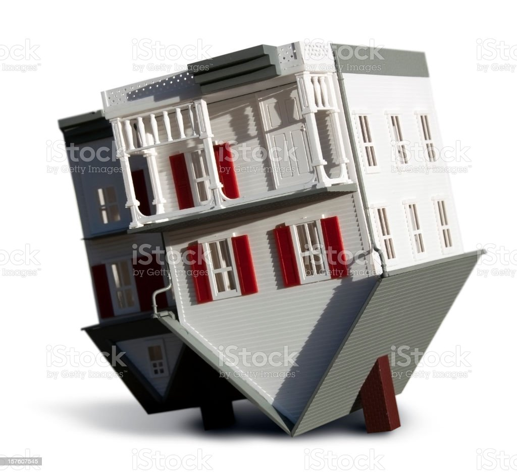 A model house that is turned upside down stock photo