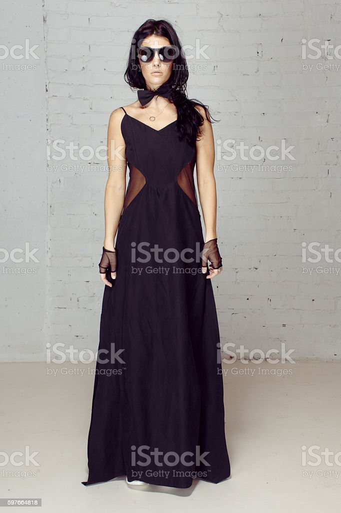 Model in black evening dress near and bow-tie stock photo