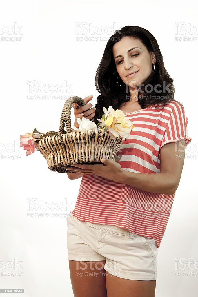 Model Looking At A Basket Of Roses royalty-free stock photo
